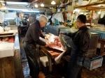 Cutting tuna with a sword.