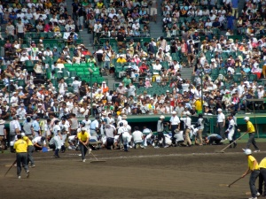 After the game, losing players scoop infield dirt to bring home.